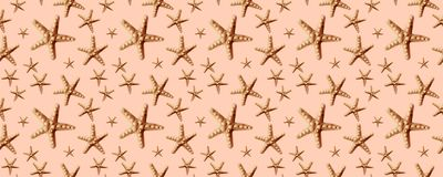 Seamless Starfish pattern on beige background. Summer time concept. Nautical pattern. stock illustration
