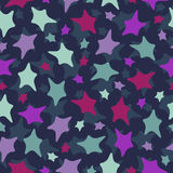 Seamless stars pattern: colorful doodles on dark b Royalty Free Stock Images