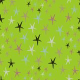 Seamless stars pattern with colorful doodles on a green background. Royalty Free Stock Images