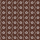 Seamless stars pattern. On a dark brown background Royalty Free Stock Photo