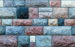 Seamless stone blocks wall. Seamles texture of a wall made of colorful stone blocks. Background Royalty Free Stock Photography