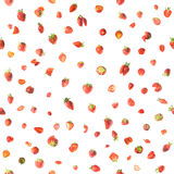 Seamless Strawberries. Strawberries pattern, fresh and some of them sliced, studio photographed and isolated on absolute white royalty free stock images