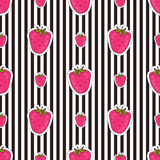 Seamless strawberry patter on striped background. Vector for textile and wrapping design. Yummy food print Royalty Free Stock Photos