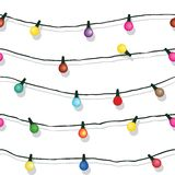 Seamless string of Christmas lights isolated on white Stock Photography
