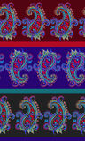 Seamless striped paisley pattern. Seamless paisley pattern with horizontal stripes. Dramatic dark traditional spicy colors. Very intricate drawing of lace like Stock Image