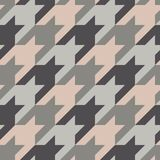 Seamless surface pattern with houndstooth ornament. Classic fashion fabric print. Checked geometric background. Seamless surface pattern design with houndstooth vector illustration