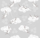 Seamless swallow and cloud pattern Stock Photos