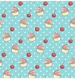 Seamless sweet pattern with cupcake and cherry on cyan Royalty Free Stock Photo