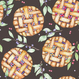 A seamless sweet pattern with the watercolor berry pie and branches of blueberry. Painted hand-drawn on a dark background Stock Images