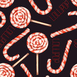 A seamless sweet pattern with the watercolor lollipop (candy cane). Painted hand-drawn on a black background. Royalty Free Stock Photos