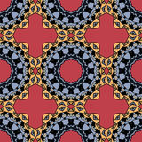 Seamless symmetrical pattern in red and yellow Royalty Free Stock Image