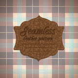 Seamless tartan pattern and label with seamless leather texture Royalty Free Stock Photo
