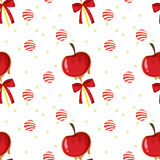 A seamless template with apples, candy balls and ribbons Stock Photos