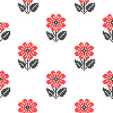 Seamless texture with abstract embroidered red flowers. Seamless texture with abstract red embroidered roses for tablecloth. Embroidery. Cross stitch stock illustration