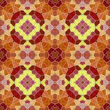 Seamless texture of abstract fabric. Kaleidoscopic wallpaper tiles Royalty Free Stock Image