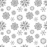 Seamless texture of abstract silhouettes symmetrical flowers Royalty Free Stock Images