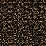 Seamless texture/background made of golden rings. On dark stock illustration