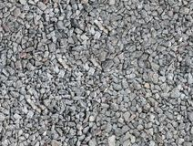 Seamless texture of the beautiful macadam. Gray, black, brown, beige, red stones are evenly scattered on the surface Royalty Free Stock Images