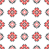 Seamless texture with black and red ornaments. Embroidery Royalty Free Stock Images