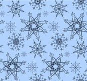 Seamless texture in blue colors with variety of snowflakes. Royalty Free Stock Photo