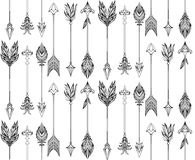 Seamless texture with boho arrows with different tips and plumage. Vector doodle pattern for your creativity Stock Photography