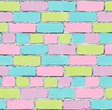 Seamless texture of a brick wall. Pastel graffiti. Inaccurate laying of bricks. Bricks are painted in pastel colors Royalty Free Stock Photo