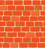 Seamless texture of a cartoon brick wall with grass Stock Photo