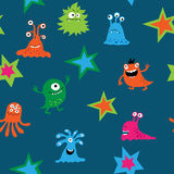 Seamless texture with cartoon monsters on a blue background. Seamless texture with a cartoon monsters on a blue background royalty free illustration