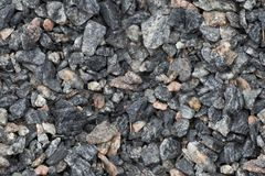 Seamless texture of close up granite breakstone gravel. Crushed stone background for design usage Stock Image
