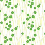 Seamless texture with clover of four leaves Stock Photography