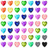 Seamless texture of colored heart cut gems isolated on white bac Royalty Free Stock Photos