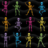 Seamless texture of colorful dancing skeletons. Vector seamless texture of dancing colorful bright fun skeletons Stock Photo