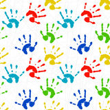 Seamless texture with colorful prints of child pal. Seamless texture with colorful prints of childrens hands Stock Image