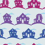 Seamless texture different houses on colour background. Seamless texture  different houses on blue background. Silhouette of home Stock Photos