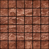 Seamless texture of dirty red stone tiles wall with spots Stock Photography