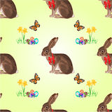 Seamless texture easter hare with butterflies and daffodil vector. Seamless texture easter hare with butterflies and daffodil and easter eggs vector illustration Royalty Free Stock Photos
