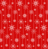 Seamless texture with festive garlands of snowflakes. Royalty Free Stock Photo