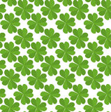 Seamless texture with flat lucky four-leaf clover Stock Photos
