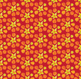 Seamless texture with floral ornament. Seamless pattern in floral theme on red background Royalty Free Stock Photos