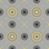 Seamless texture with a floral ornament. Yellow and gray colors Royalty Free Stock Photos