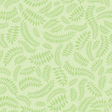 Seamless texture with floral theme. Seamless pattern with autumn leaves on light green background Royalty Free Stock Photos