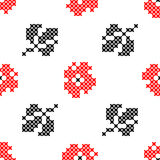 Seamless texture of flowers. Seamless  texture with abstract red embroidered carnations with leaves for tablecloth. Embroidery. Cross stitch Stock Photo