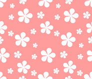 Seamless texture with flowers on pink background. Royalty Free Stock Photo