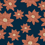 Seamless texture of flowers of water lilies on a dark blue background Royalty Free Stock Image