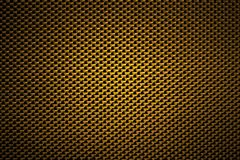 Seamless Texture of Golden Carbon Fibers Cloth stock image