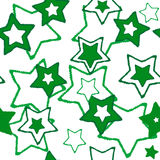 Seamless texture with green stars Royalty Free Stock Photos