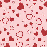 Seamless Texture of heart on red background. Royalty Free Stock Photo