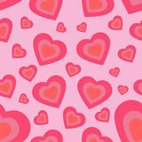 Seamless texture of hearts on a pink background Stock Images