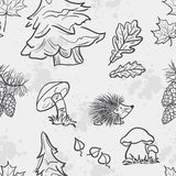 Seamless texture with the image of funny little animals, trees, fungi and leaves Royalty Free Stock Images