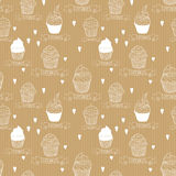 Seamless vector texture. Kraft paper with cupcakes. Ready design for wrapping paper, candy store, etc. Business background Stock Image